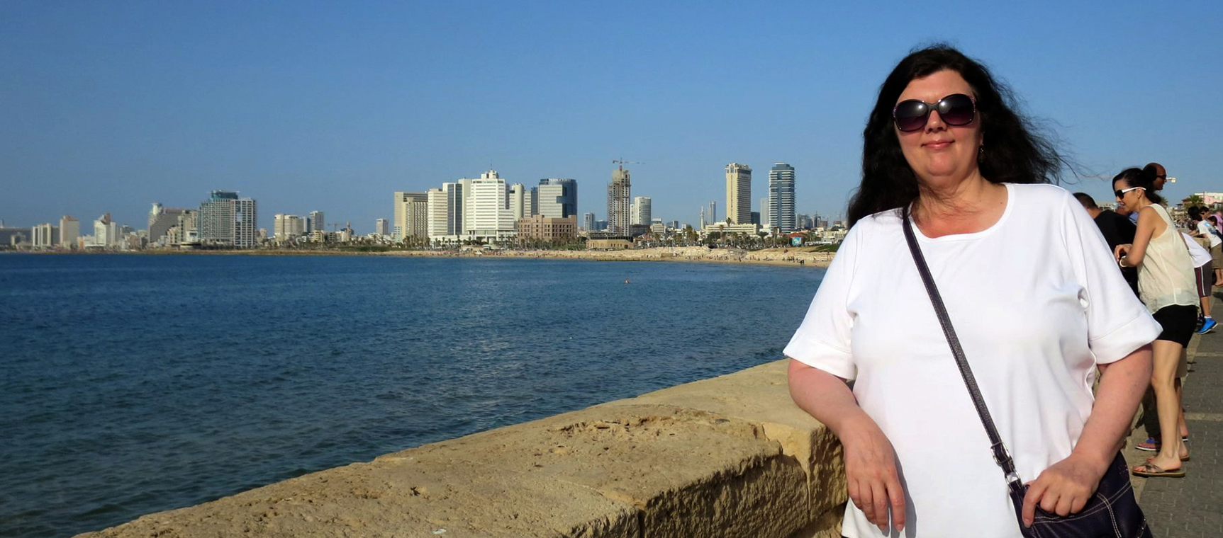 Lorie Kennerly poses by the Mediterranean Sea in Israel.