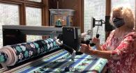 Diane Ostergaard sewing kennel blankets.